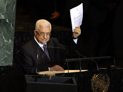 Mahmoud Abbas, President of the Palestinian Authority, showing a copy of the letter requesting Palestine's full admission to the UN as a sovereign state during the United Nations General Assembly on September 23, 2011. (AFP Photo / Timothy A. Clary)