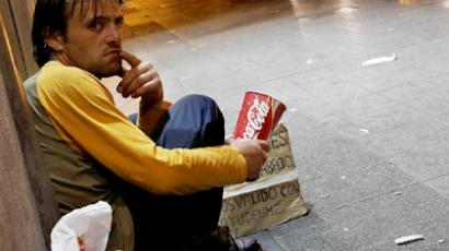A man begs on the street in central Madrid July 19, 2012 (Reuters/Susana Vera)