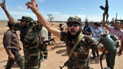 Families of Gaddafi aides flee Sirte as clashes continue