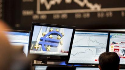 A trader sits in front of screens showing the German DAX index in Frankfurt am Main on November 1, 2011 at the German Stock Exchange (AFP Photo / Frank Rumpenhorst / Germany Out)