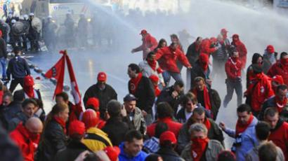 Police fire a water cannon to disperse Belgian socialist union demonstrators in the streets around the European Union headquarters in Brussels, Belgium, 24 March 2011 (image from vosizneias.com / Credit: EPA)