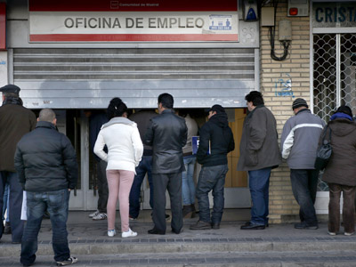 People wait to enter a government-run employment office in Madrid January 3, 2013. (Reuters/Susana Vera)
