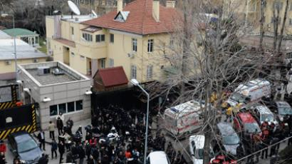 Riot police block a street after an explosion at the entrance (far right) of the U.S. embassy in Ankara February 1, 2013 (Reuters / Stringer)