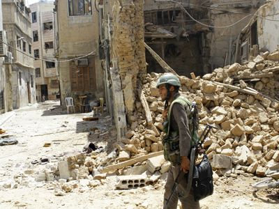A Syrian army soldier walks in a partially destroyed neighborhood in the al-Midan area in Damascus on July 20, 2012 (AFP Photo / Louai Beshara)