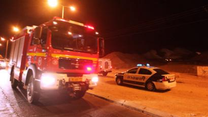 : Police and rescue services arrive at the scene of a rocket attack in the Israeli Red Sea resort of Eilat, on August 15, 2012. (AFP Photo/Jack Guez)