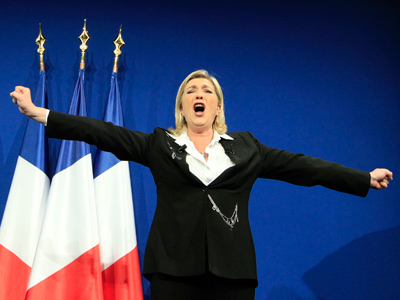 Marine Le Pen, National Front Party Candidate for the 2012 French presidential election, salutes supporters in Paris after early results in the first round vote of the 2012 French presidential election, April 22, 2012 (Reuters/Pascal Rossignol)