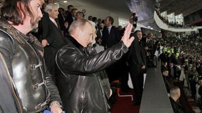 "Russian Prime Minister Vladimir Putin, center, and members of ""Night Wolves"" bikers' movement at a friendly football match between junior teams of FC Crvena Zvezda Belgrade and FC Zenit St Petersburg at Marakana Stadium. (RIA Novosti / Aleksey Nikolskiy)"