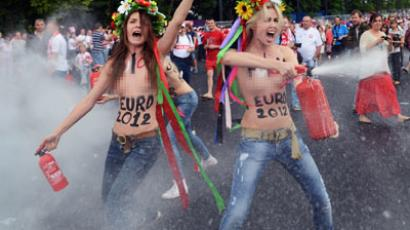 Members of Ukrainian feminist group Femen protests against prostitution near the National Stadium in Warsaw on June 8, 2012 (AFP Photo / Janek Skarzynski)