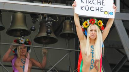 'Kill Kirill': Topless FEMEN activist attacks Russian Patriarch (VIDEO, PHOTOS)