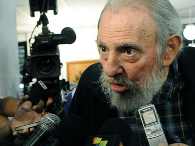 Former Cuban leader Fidel Castro speaks to reporters at a polling station in Havana February 3, 2013. (Reuters)