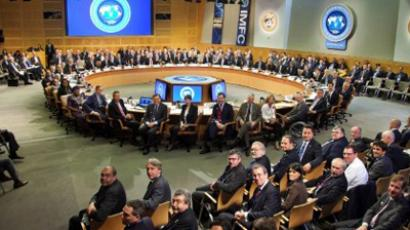 In this image released by the International Monetary Fund, IMFC members pose for a group photograph at the International Monetary Fund Headquarters September 24, 2011 in Washington, DC (AFP Photo / International Monetary Fund / Stephen Jaffe)