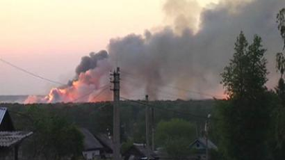 Two elderly people suffered heart attacks due to stress and died in the result of massive explosions triggered by the fire at the ammunition depot near Izhevsk (RIA Novosti / STF)