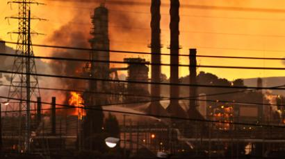 Firefighters douse a flame at the Chevron oil refinery in in Richmond, California August 6, 2012 (Reuters / Josh Edelson)