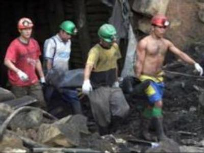 Flooding stops search for two Siberian coal miners