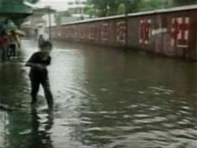 Floods and landslides kill 21 in China