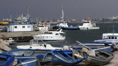 Libyan fishing boats are seem at the port in Tripoli on April 21, 2011 (AFP Photo / Mahmud Turkia)