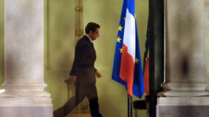 FRANCE, Paris: French president Nicolas Sarkozy is pictured at the Elysée palace on January 13, 2012 in Paris, after a meeting with French Economy minister François Baroin amid rumors of the downgrade by Standard & Poor's of France's credit rating by one notch to AA+  (AFP Photo / MIGUEL MEDINA)