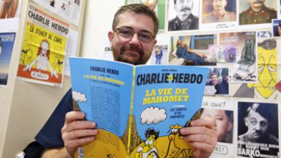 "French satirical weekly Charlie Hebdo's publisher, known only as Charb, presents his new comic strip named ""La Vie de Mahomet"" (The life of Mohammed) in Paris (AFP Photo / Francois Guillot)"