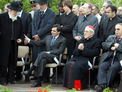 French Education Minister Francois Fillon (2nd L), helps Chief Rabbi of France Joseph Sitruk (L) as they attend a ceremony with Cardinal of Paris Jean-Marie Lustiger (2nd R) and President of the French National Muslim Council Dalil Boubakeur (R) near the Jewish cemetery of Herrlisheim, Eastern France. (Reuters/Vincent Kessler)