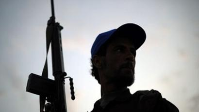 A Libyan rebel fighter at check point on the outskirts of the Libyan eastern city of Ajdabiya on May 19, 2011 (AFP Photo/ Saeed Khan)