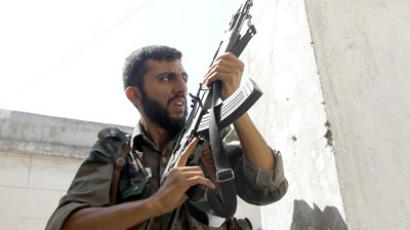 A Free Syrian Army fighter holds his rifle during clashes in Aleppo August 16, 2012. (Reuters/Goran Tomasevic)