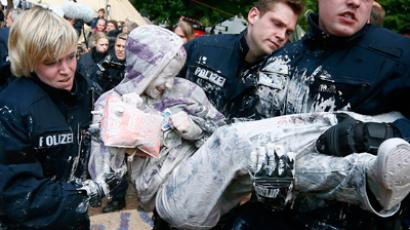 Policemen carry away a protester as they close down the Occupy Camp in front of the European Central Bank (ECB) in Frankfurt/Main, western Germany, on May 16, 2012. (Reuters/Kai Pfaffenbach)