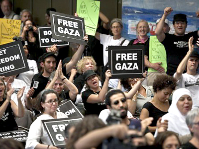 "Greece, Athens: Activists hold banners reading ""Free Gaza"" and ""Let freedom ring"" during a press conference in Athens on June 27, 2011 (AFP Photo Jean-Philippe Ksiazek)"