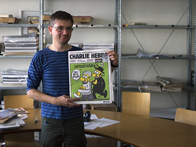 French satirical weekly Charlie Hebdo's publisher, known only as Charb, presents to journalists, on September 19, 2012 in Paris. (AFP photo/Fred Dufour)