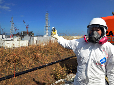 A journalist checks radiation levels with her dosimeter near the crippled TEPCO's Fukushima nuclear plant 28, 2012 (Reuters/Yoshikazu Tsuno/Pool)
