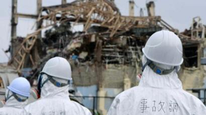 Members of a governmental panel inspecting the damaged building housing reactor number three at the Fukushima Dai-ichi nuclear power plant, Fukushima prefecture (AFP Photo / HO / Japanese Goverment via Jiji Press)