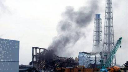 This handout picture released by Tokyo Electric Power Company (TEPCO) via Jiji Press on March 21, 2011 shows black smoke rising from reactor number three of the number 1 Fukushima dai-ichi nuclear power plant at Okuma town in Fukushima prefecture (AFP Photo / HO / TEPCO via Jiji Press)