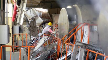 This handout picture, taken by Tokyo Electric Power Co (TEPCO) on March 17, 2011 and released on February 1, 2013 shows a worker removing debris at the dry cask storage building at the Fukushima Dai-ichi nuclear plant at Okuma town in Fukushima prefecture (AFP Photo / TEPCO)