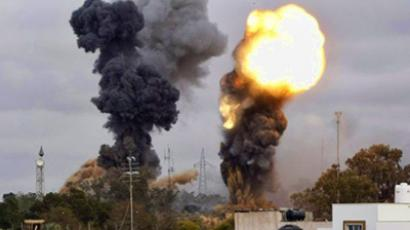 Smoke billows as seven explosions rocked the Libyan capital Tripoli, some in the vicinity of the tightly-guarded residence of leader Moamer Kadhafi and military targets, on March 29, 2011. (AFP Photo / Mahmud Turkia)