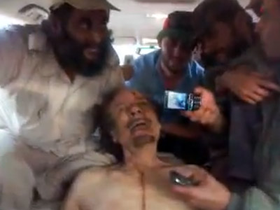 'Send this to Assad': New shock video shows rebels mocking Gaddafi body
