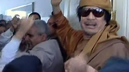 "Libyan leader Moamer Kadhafi arriving at the ""Jeel al-Wehda"" (Unity Generation) school in the Zenata district of the capital Tripoli, to visit the children. (AFP Photo)"