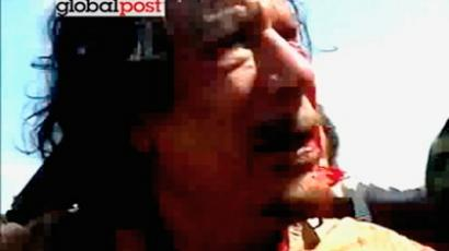 This still image taken from amateur video posted online by GlobalPost and obtained by Reuters, October 21, 2011, shows former Libyan leader Muammar Gaddafi after his capture by NTC fighters in Sirte (Reuters / GlobalPost via Reuters TV / Handout)