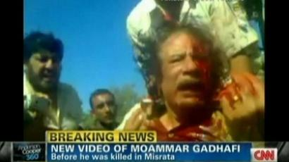 This still image from YouTube courtesy of CNN from October 20, 2011 shows the bloodied Libyan strongman Muammar Gaddafi (AFP Photo / CNN)