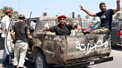 Lybia,Tripoli : Libyan rebel fighters patrol near the newly named Martyr's Square, formerly known as Green Square, in the capital Tripoli on August 24, 2011. (AFP Photo / Mahmud Turkia)