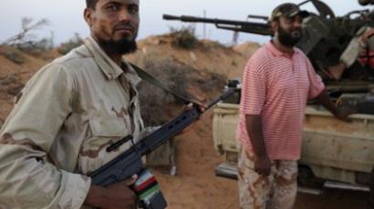 NTC fighters from the Zintan Martyr Brigade rest near the front line close to Umm Khanfis, some 80 km east of Sirte, on September 4, 2011, (AFP Photo / Eric Feferberg)