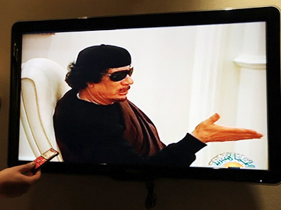Gaddafi appears on TV after two-week absence