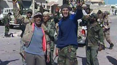 Celebratory gunfire has echoed through Sirte. Still from AP video, Sirte.