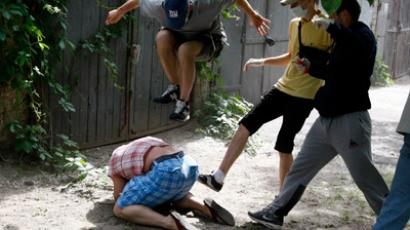 Unidentified people beat Svyatoslav Sheremet in Kiev, May 20, 2012 (Reuters/Anatolii Stepanov)