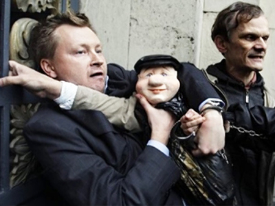Police detain a gay rights activist holding a puppet of Moscow Mayor Yuri Luzhkov during an unsanctioned protest in Moscow September 21, 2010