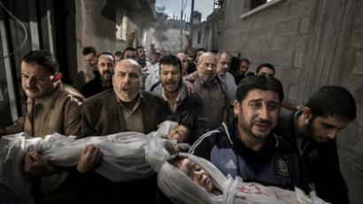 This handout photo taken by Swedish photographer Paul Hansen and released by the World Press Photo shows the bodies of two year-old Suhaib Hijazi and her three-year-old brother Muhammad, who were killed when their house was destroyed by an Israeli missile strike, being carried on November 20, 2012 in Gaza City (AFP Photo / Paul Hansen)