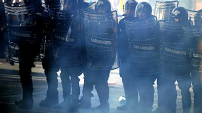 Riot policemen run after demonstrators during a protest on a day of mobilisation against austerity measures by workers in southern Europe on November 14, 2012 in Rome. (AFP Photo / Filippo Monteforte). Video: clashes in Milan (courtesy - YouTube user knes88)