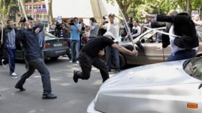 Georgian opposition supporters clash with plastic rods calling for the resignation of President Mikhail Saakashvili in Tbilisi, Georgia, Sunday, May 22, 2011 (Photo from www.daylife.com)