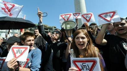 Georgian opposition activists hold posters during a rally against President Saakashvili in the centre of Tbilisi on May 21, 2011 (AFP Photo / Vano Shlamov)
