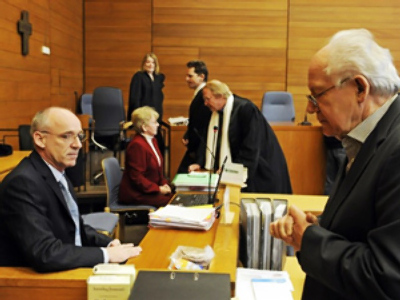The defendants Roland K.(R) and Wilhelm D. (L) arrive at the district court in Traunstein near Munich on February 8, 2010 (AFP Photo DDP / Joerg Koch Germany out)