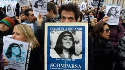 Pietro, brother of Emanuela Orlandi holds a banner with her picture in front of St. Peter square as Pope Benedict XVI leads the angelus prayer December 18, 2011 (Reuters/Stringer)