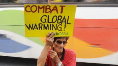 Environmental activists stage a rally near the US embassy in Manila on December 3, 2011, demanding more action to stop climate change (AFP Photo / JAY DIRECTO)
